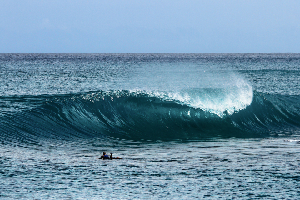 Surf guide Aaron Wright eyeing off a perfect Mentawai slab