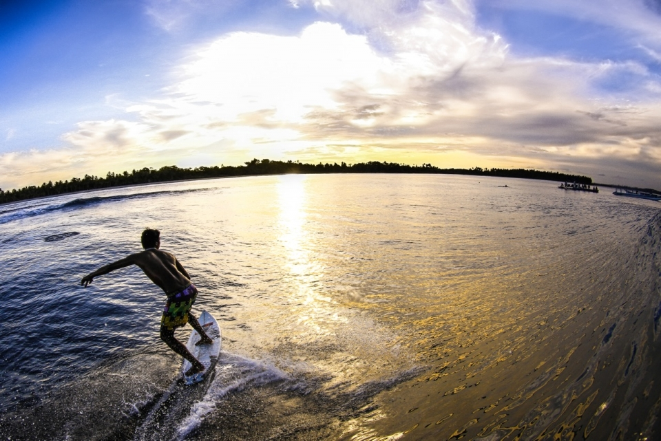 Photog Kaliang Black puts down his camera and enjoys a glide into the sunset.