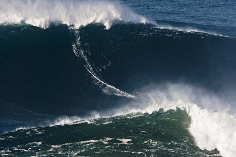 GARRETT McNamara makes the XXL again after being towed into a bomb off Nazare in Portugal by Andrew Cotton. It is being called 90ft, making it one of the biggest waves ever ridden.