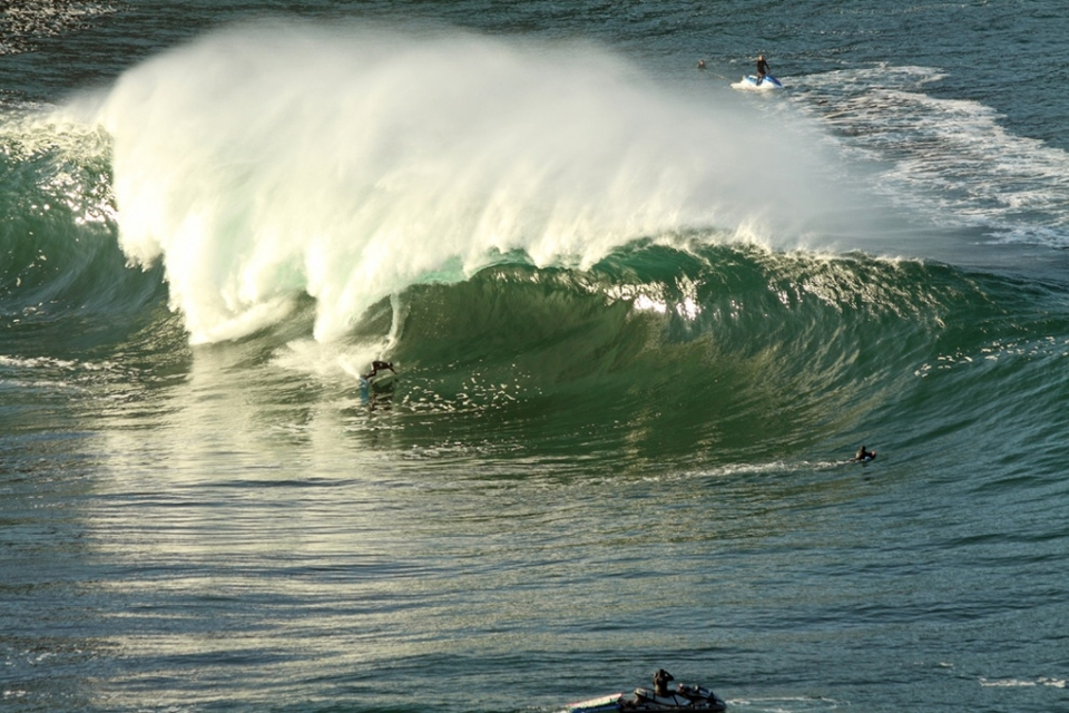 Lahinch local, Ollie O'Flaherty pushing himself with a huge bottom turn into the jaws of this beast.