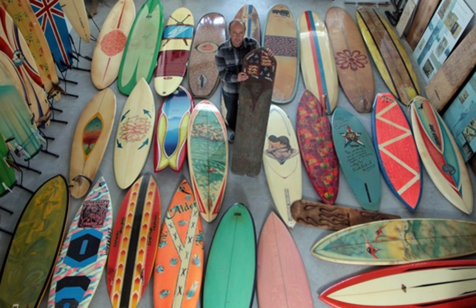 Founder, Pete Robinson, selecting surfboards for display