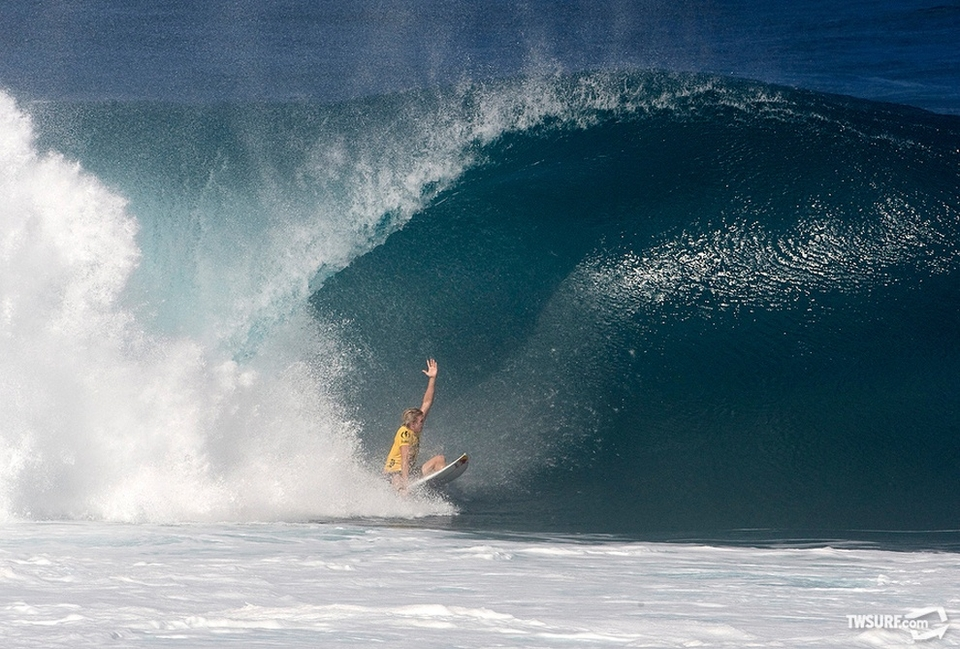 Jamie O'Brien kayaks one out after coming unstuck in a giant barrel.