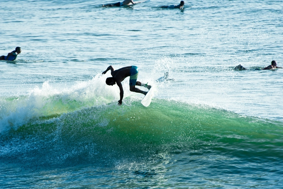 Back at the pier, Adam King breaks the fins loose while putting it on rail on a chunky north side bowl.