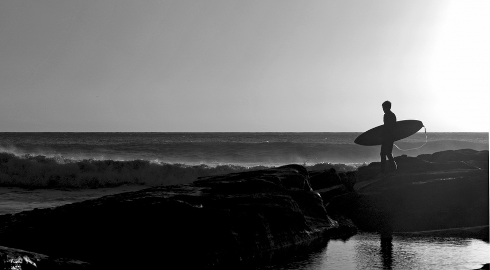 Craig Steward's  silhouetted surfer scoping out a late afternoon set at Anchor Point, Morocco.