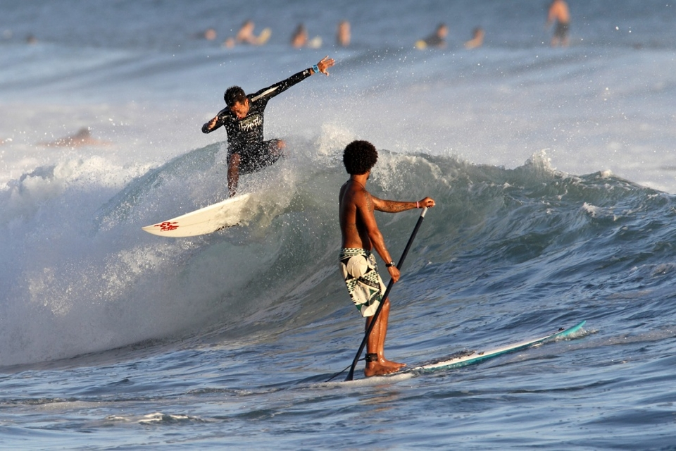Billy Choy's the one surfing and perhaps Kealii Mamala is thinking,