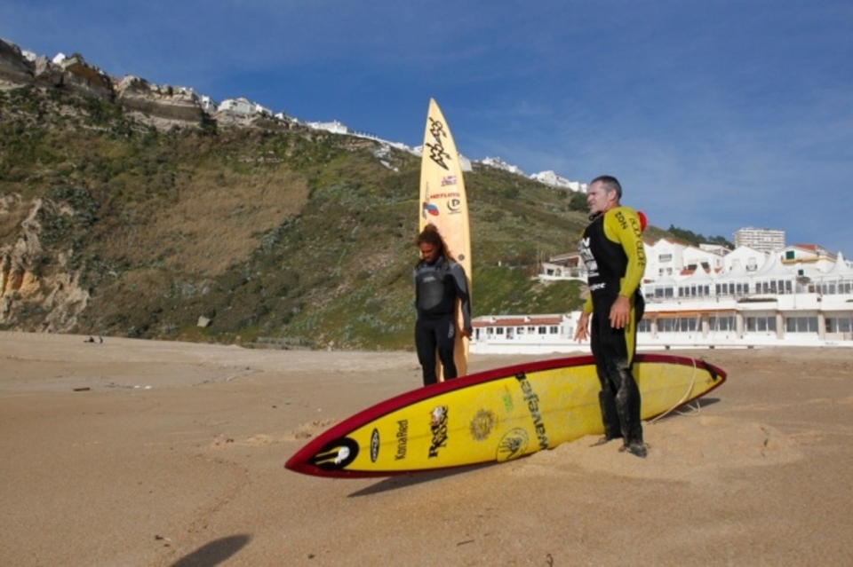 Kealli Mamala (left) and Garrett getting ready to paddle out