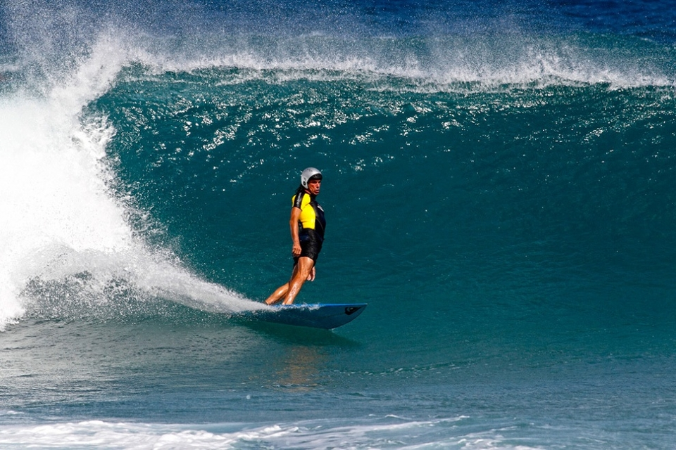 Bali Joe, a long time fixture on the North Shore, likes old school single fin boards and charges everything.