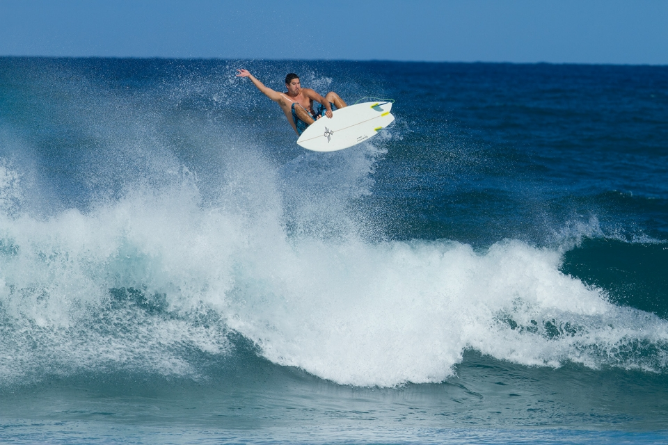 I don't know who this is, but I'm pretty sure that they weren't busting massive aerials on twin fins, back in the day.
