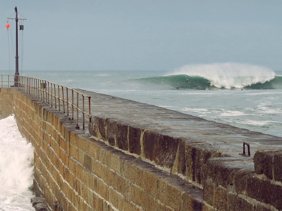 Brooke Mason bartering with a Porthleven pit on the 29th of March during the first licks of the new swell.