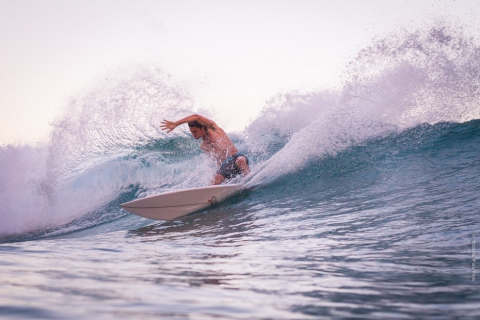 Rocky Point, Oahu.  I woke up this morning and could hear the sets coming in from my bed. The swell arrived the night before and was already here. I sent the word over and we were ready before sunrise. We arrived at Rockies to find light winds and grinding lefts. This shot is of talented surfer, Brian Pollak, hacking out his first wave of the morning. Shot at 6:25am in the good morning light with my trusty 50mm.