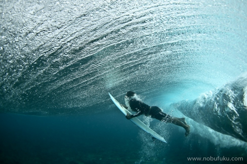 Lacerations, Nusa Lembongan.  Balinese surfer, Made Artah duck diving at one of Indonesia's most treacherous reefs.