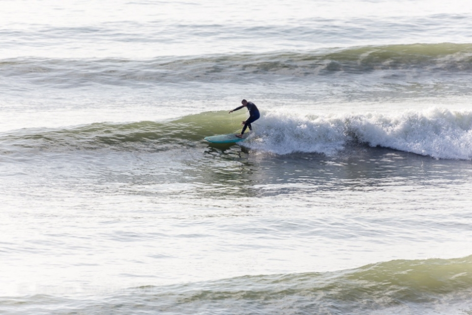 The swell even made its way up to the Isle of Wight, greeted by a very contented longboarder.