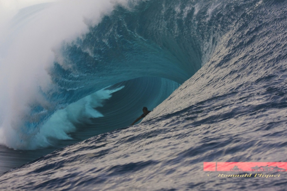 Teahupoo, Tahiti.  It was an incredible day at Chopes. This magical ride of an unknown Brazilian surfer closed this epic day after many dangerous situations. This guy waited all the day behind the line up and finally he got his reward just before the sunset. And to finish off the story, he made the wave.