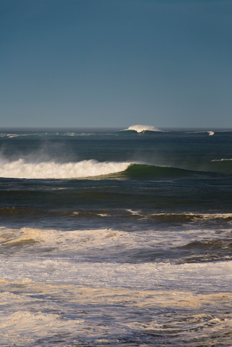 Squint your eyes and you can  make out a small white line splicing through a Belharra bomb. Stephanie Ralour and Alain Riou were among the few to take on Fance's best known XXL wave.