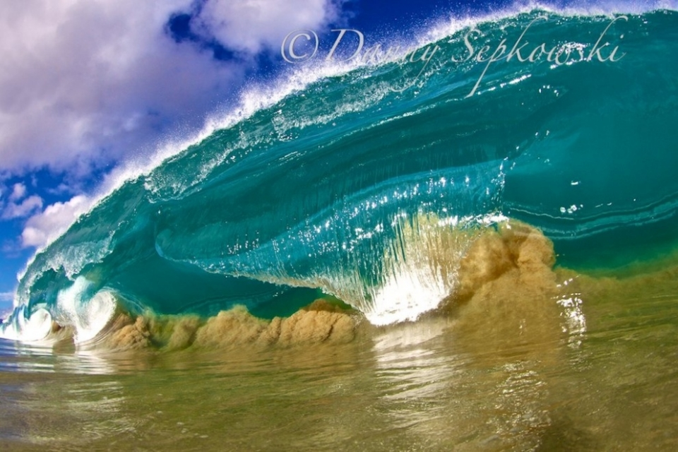 Waimea Bay, Oahu.  The waves are starting to come alive in Hawaii. With massive swells and a lot of sand that has been resting in the summer months, it is a great time to get images like this. I had to work on this day but decided to find a way to get out of it somehow. This spontaneous decision paid off. The ocean dumps its power onto this shallow sand shelf causing pristine moments but yet dangerous. I got bulldozed by this wave and can still feel it.