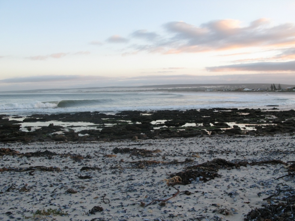 Elands Bay, South Africa.  It was the first wave to come through and the first shot. By this time our frothometer had gone into the red and we had to run back to the car to suit up. This is what we woke up to, and at one point there were only six of us in the water.