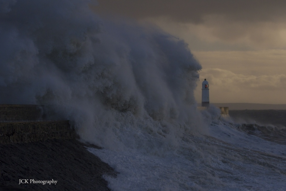 Storm swell smashing the pier/seawall at  Porthcawl.