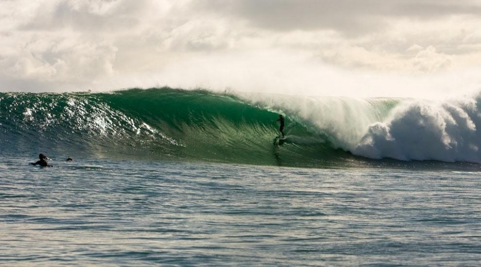 Lombok, Indonesia.  That day was just magic. It started in the morning with 2 to 4ft, then in the afternoon, around low tide it started to get massive. During the Indo off season Gili Air can get really good, through January or February, or even March. Oh yes, of course he made the barrel; he's a local surfer and the waves were pumping!