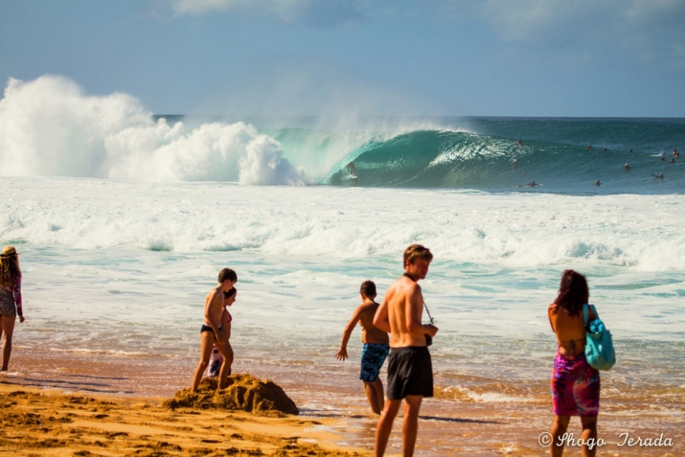 Pipeline, Oahu.  A classic Pipe shot, complete with thick tube and oblivious bystanders.