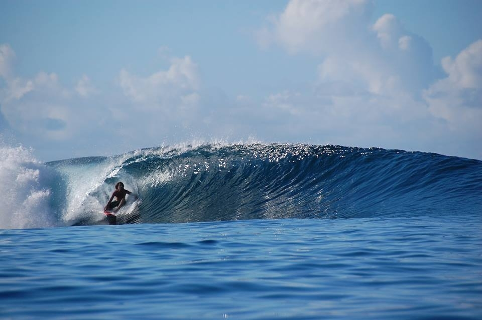 Salailua, Samoa.  The surfer is Neil Lumsden.  It was as good as it looks. He stayed out for hours!