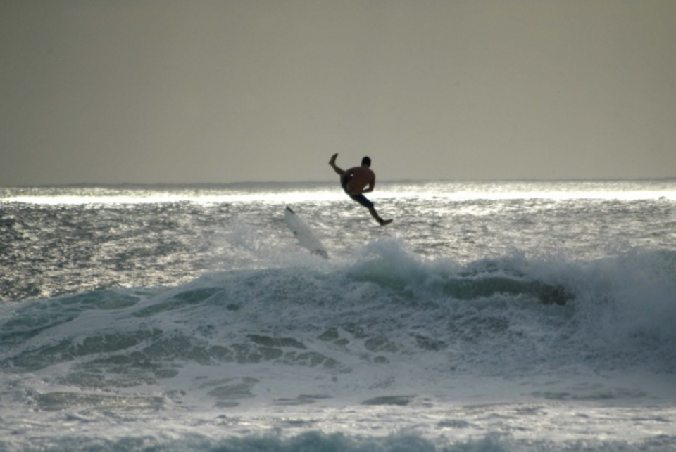 An unknown surfer exits a wave at the Maria's break in Rincon.