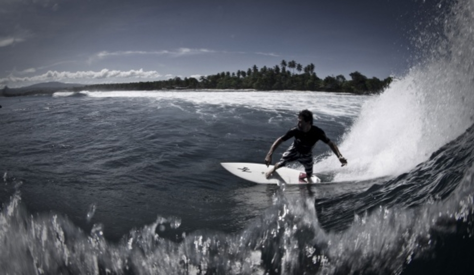 Slipping inside Karang Nyimbor ... Gavin Graham surfing and Carlo Monaghan up top
