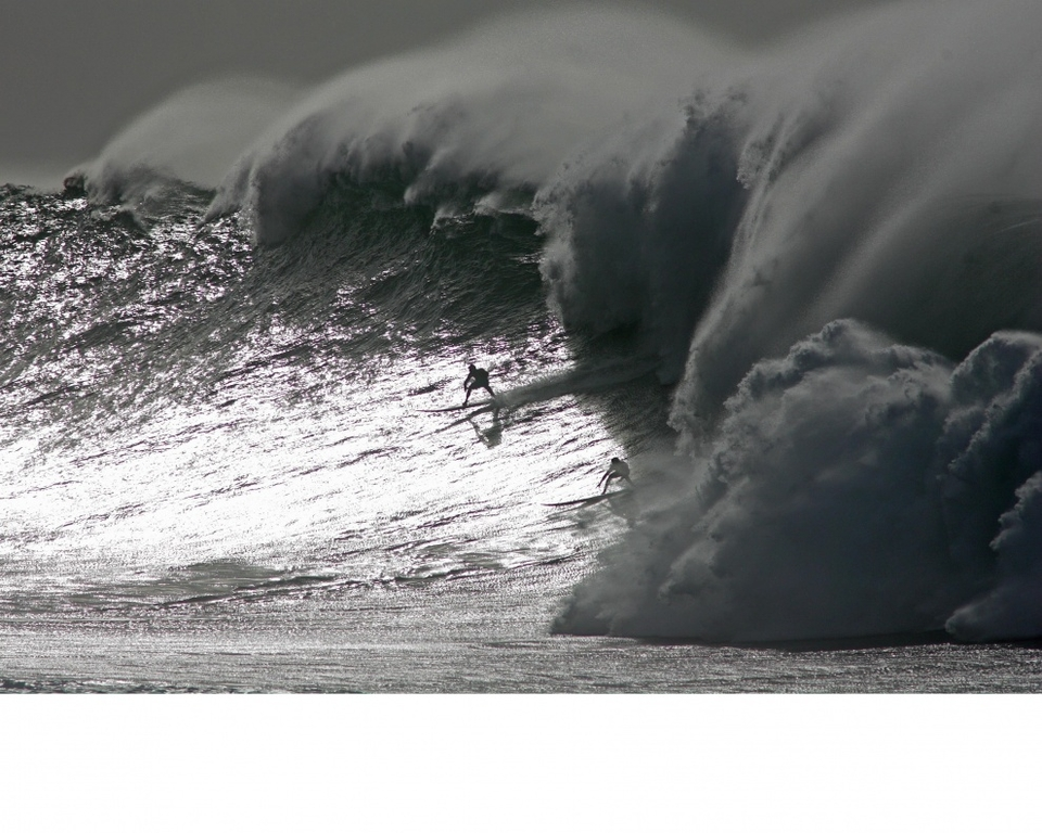 Expect the Islands be get another super-sized swell.    Probably not as perfect as this wall of darkness caught by Shane Dorian and Mark Healey at Waimea Bay December 7 but just as big.