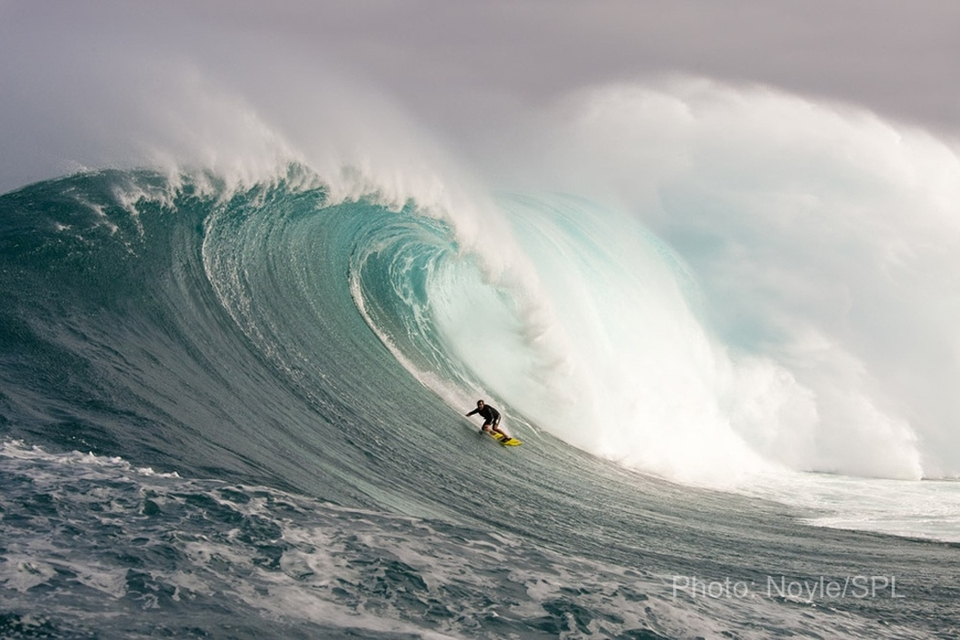 Carlos Burle looking for the glory hole on a massive one.