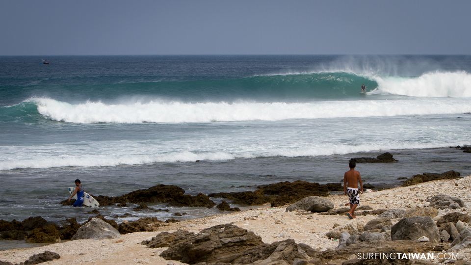 Gugu paddling out for his third session as Vince sets his line.