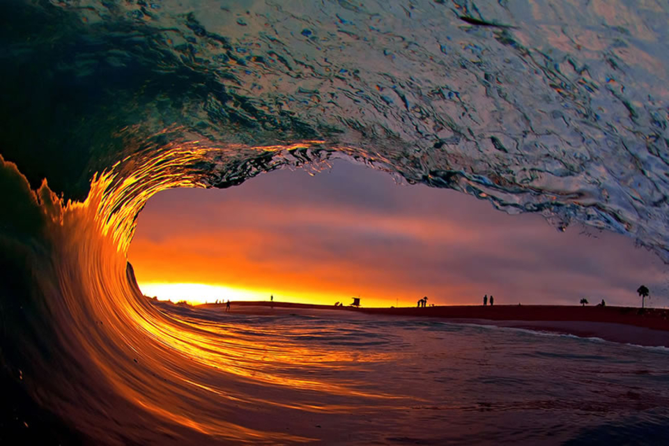 Looking out of a glassy California barrel during sunset at the famous shorebreak The Wedge.