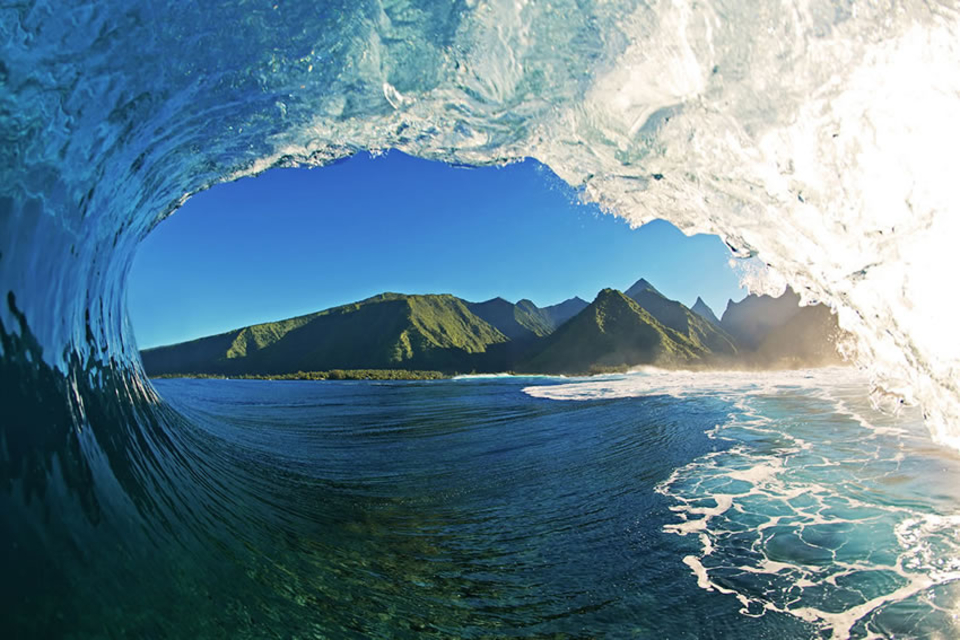 Taken during a morning photo session from inside the tube of a well known Tahiti wave.
