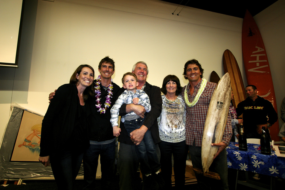 The Long family celebrate with Greg. Should he want to quit surfing there's a lucrative Elvis lookalike gig begging to be filled.