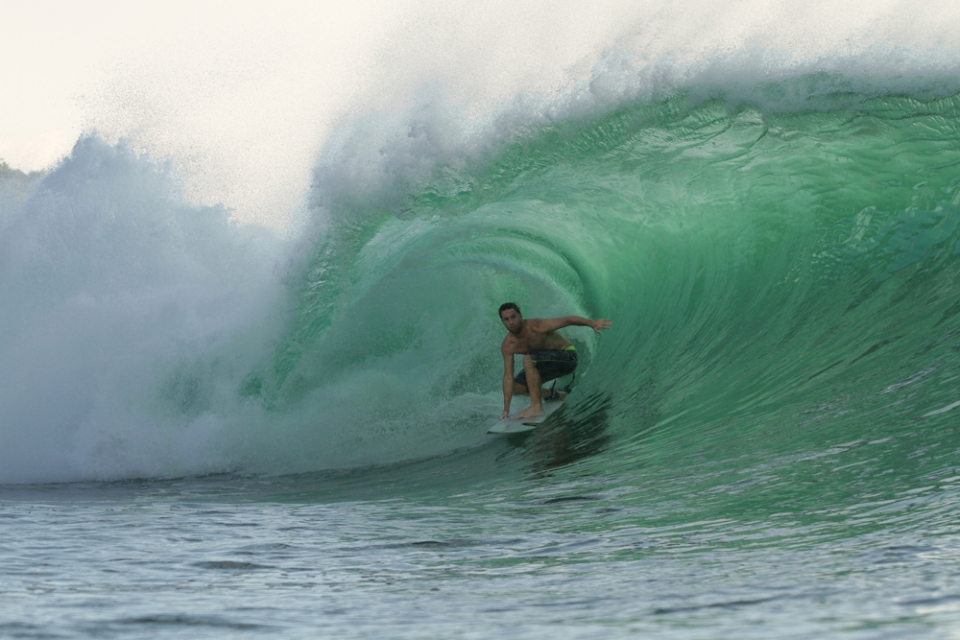 John McGuirl, an American surfer from Boston is addicted to barrels. He's always searching for empty waves.
