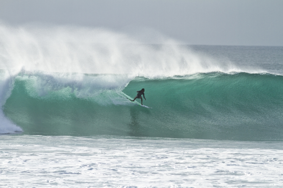 Alik Rudiarta, a local Uluwatu surfer is always working to find the right moment in time at his home spot. He came 4th in the Rip Curl Cup at Padang Padang, held just around the corner in his neighbour's yard.