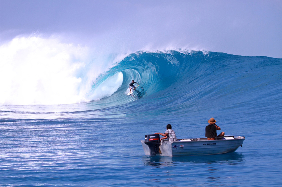 Koa Rothman locks into a bomb whilst the menacing end section draws off the reef.