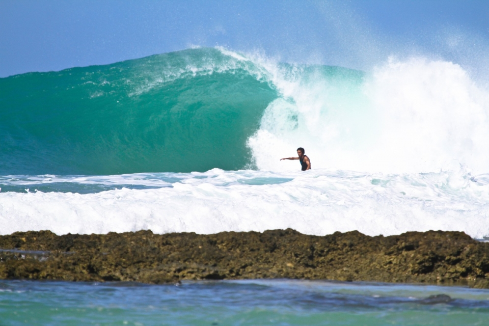 Matt Maheri scores a perfect pit at this unnamed slab.  This slab turns on a couple times a year and is one of the shallowest in the Mentawais.