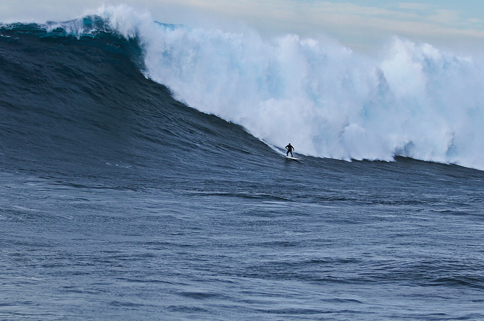 Shaun Dollar on his way down the face of 61ft world record. He captured both the Pacifico Paddle and XXL Biggest Wave Awards.