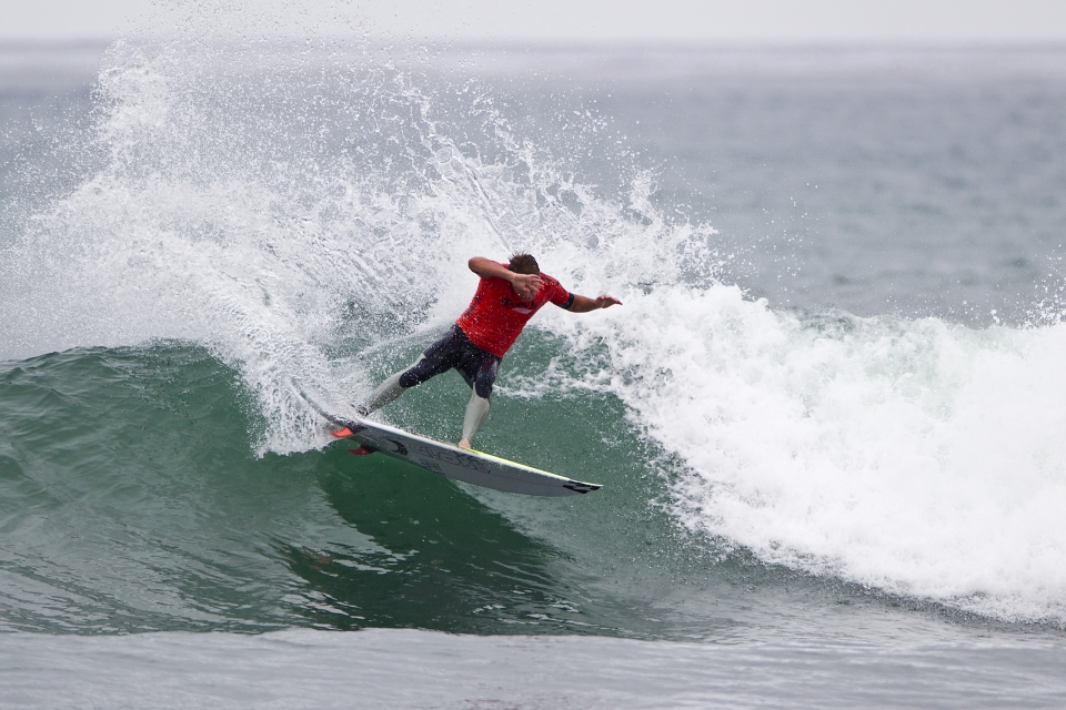 Taj Burrow in the process of taking down Kolohe Andino.