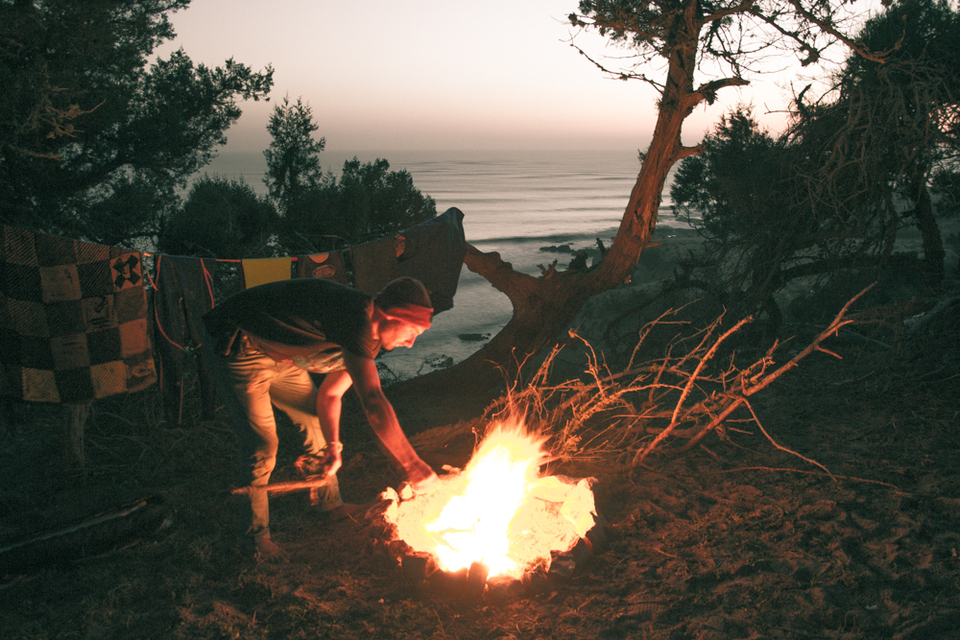 Fire building duties after a long day of waves.