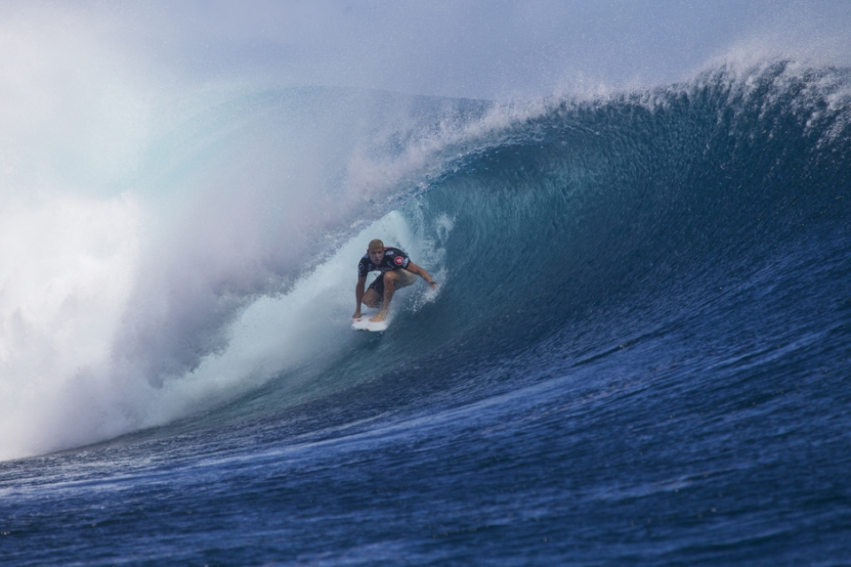 Mick Fanning pumping back hand through the barrel for what would prove to be a heat too far.