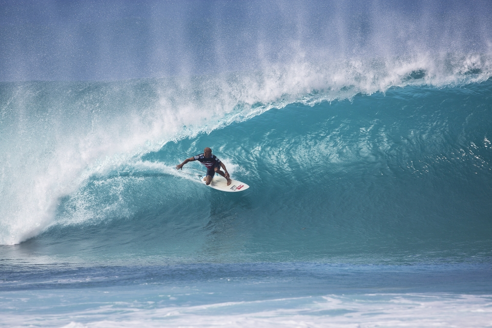 "One of many beautiful backhand tubes from the seven time Pipe Masters champion.  ""Today was one of the most special days in my life,"" said Slater, following the win. ""It's a day I have dreamed about since I was a little kid – big, perfect, west-angled Pipeline and a showdown at the Pipe Masters. If I had stepped away from the sport five years ago, I wouldn't have had today. I want more days like this so I'm definitely back next year."""