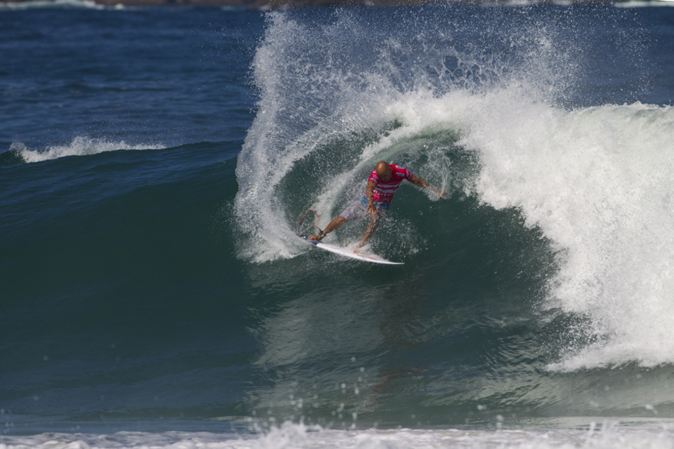 """Kelly Slater returned to Rio de Janeiro today after a 2012's absence due to a foot injury, one that might have cost him the World Title.      """"Based on the years prior, I thought last year was going to be turns and maneuvers and there were a lot of barrels,"""" Slater said. """"I had stitches in my heel last season and could probably have attended if it was just barrels, but I couldn't really do turns with the stitches in my heel. Lesson learned and I'm here this year."""""""