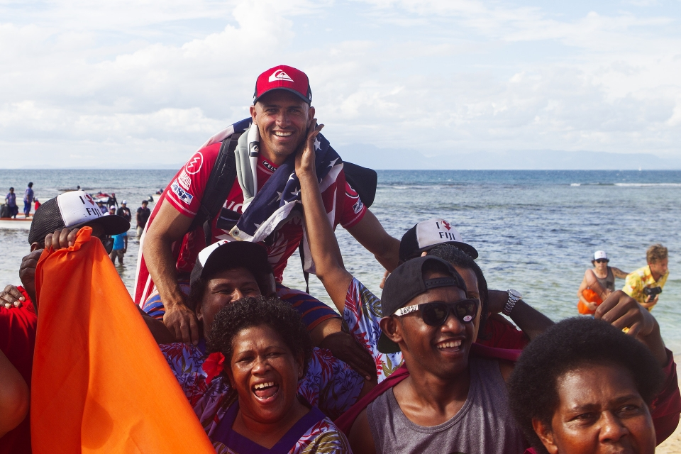 A victorious Kelly Slater celebrates his Fiji Pro win ... did we say they love him here?