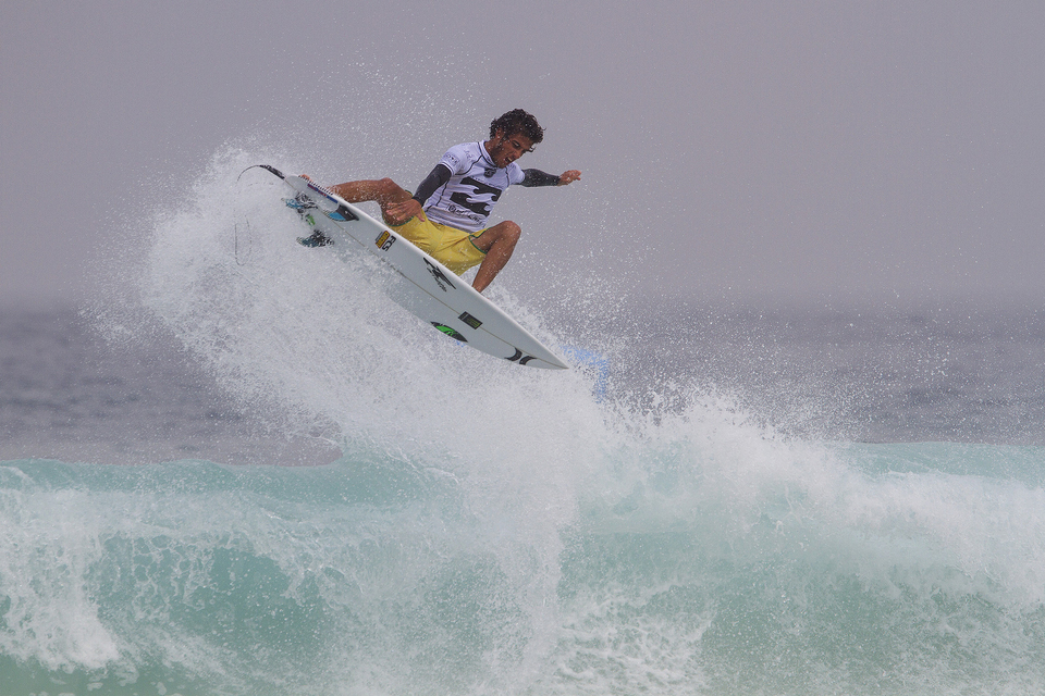 "Felipe Toledo on his way to a comprehensive heat win over Julian Wilson and Artiz Aranburu.  ""It's so good to be here in Brazil and competing at home in front of all the crowds and my friends and family,"" said Filipe Toledo. ""My board is feeling good and I'm feeling really comfortable. The Brazilian crowd is great for me and it's amazing to be here. When I'm surfing and I hear the crowd cheering it really motivates me."""