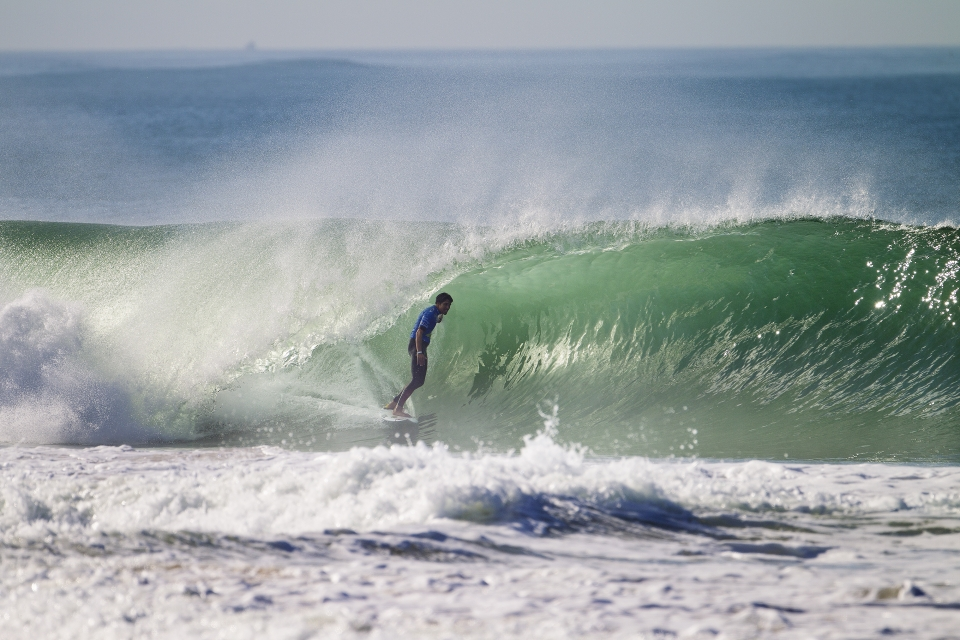 Supertubos showed occasional signs of its excellence, however, for much of the day, the Portuguese Pipeline offered scanty scoring opportunity for the world's best. Wildcard, Francisco Alves, stands tall in a rare moment of brilliance.