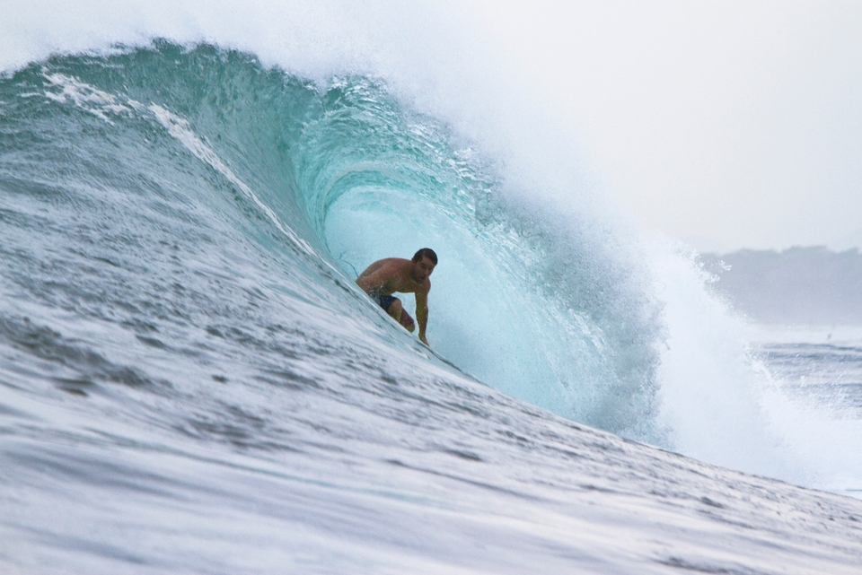 Kalani Chapman (Hawaii) relishing some serious oceanic juice while his home waters lie dormant.