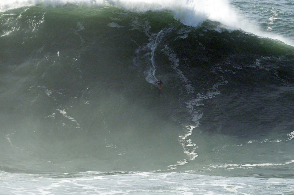 Russell Bierke on a monster before it was down time, copping a double wave hold down. Brutal.
