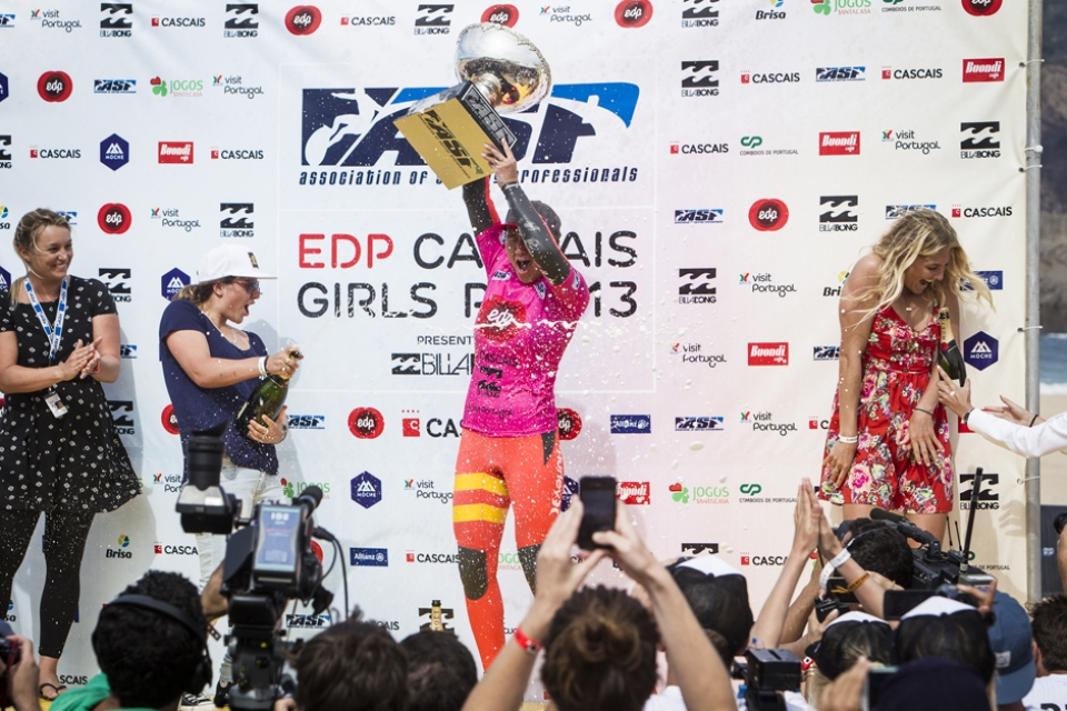 Steph Gilmore has had plenty of champagne showers in her time. Here she evades the spray as Moore takes drinks in the moment.