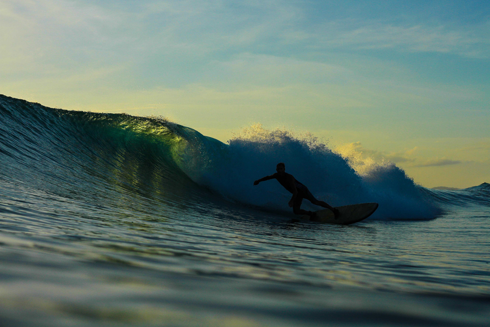 Waterman and Mentawai guide Aaron Wright on a late arvo Roxy's peak