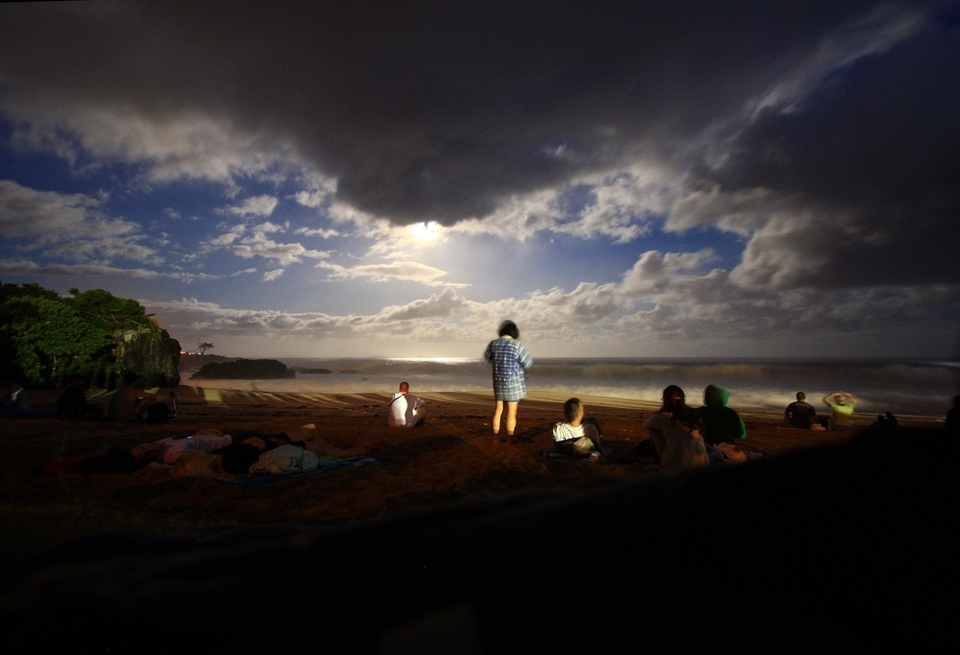Full moon glow over Waimea Bay illuminates the expectant crowd gathering on the beach. It's 5am and they're all there, barbecues in tow, ready for what is an almost annual pilgrimage.      Kala Alexander says